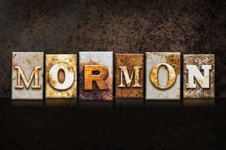 mormon temple: The word MORMON written in rusty metal letterpress type on a dark textured grunge background.