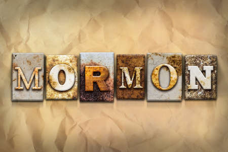 mormon: The word MORMON written in rusty metal letterpress type on a crumbled aged paper background.