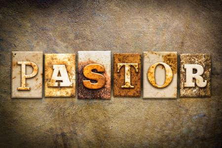 letterpress words: The word PASTOR written in rusty metal letterpress type on an old aged leather background.