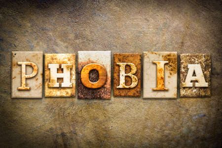 phobia: The word PHOBIA written in rusty metal letterpress type on an old aged leather background. Stock Photo