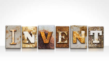invent: The word INVENT written in rusty metal letterpress type isolated on a white background.
