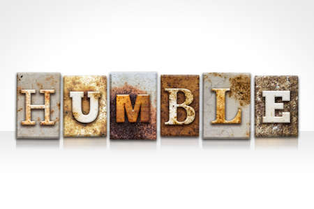 The word HUMBLE written in rusty metal letterpress type isolated on a white background. Stock Photo