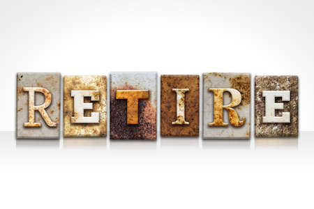 retiring: The word RETIRE written in rusty metal letterpress type isolated on a white background.
