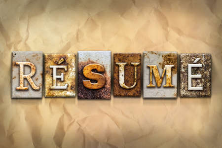 resumed: The word RESUME written in rusty metal letterpress type on a crumbled aged paper background.