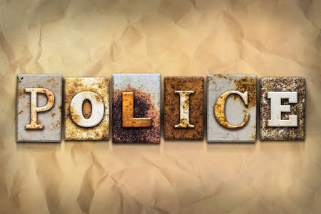 police unit: The word POLICE written in rusty metal letterpress type on a crumbled aged paper background. Stock Photo