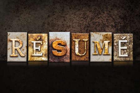 resumed: The word RESUME written in rusty metal letterpress type on a dark textured grunge background.