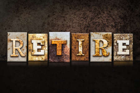 retiring: The word RETIRE written in rusty metal letterpress type on a dark textured grunge background.