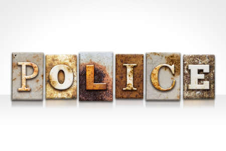 constable: The word POLICE written in rusty metal letterpress type isolated on a white background. Stock Photo