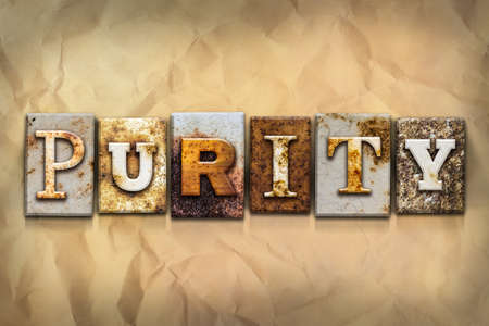 purity: The word PURITY written in rusty metal letterpress type on a crumbled aged paper background.