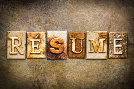 resumed: The word RESUME written in rusty metal letterpress type on an old aged leather background. Stock Photo