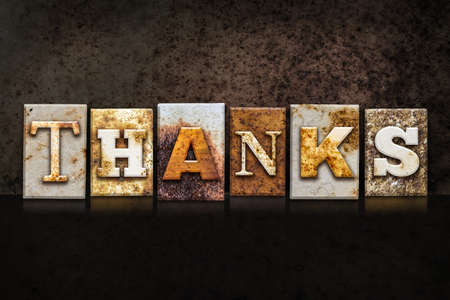 thankfulness: The word THANKS written in rusty metal letterpress type on a dark textured grunge background. Stock Photo