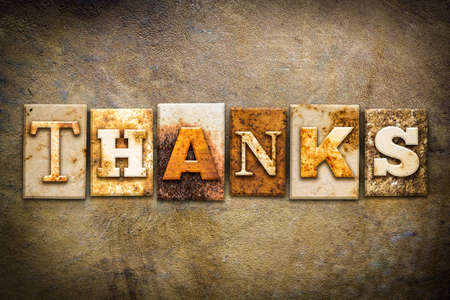 thankfulness: The word THANKS written in rusty metal letterpress type on an old aged leather background. Stock Photo