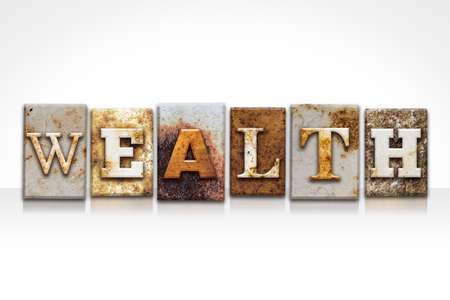 letterpress words: The word WEALTH written in rusty metal letterpress type isolated on a white background. Stock Photo
