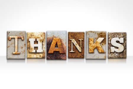 thankfulness: The word THANKS written in rusty metal letterpress type isolated on a white background.