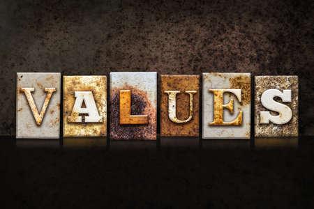 The word VALUES written in rusty metal letterpress type on a dark textured grunge background.