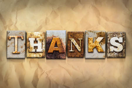 gratefulness: The word THANKS written in rusty metal letterpress type on a crumbled aged paper background.