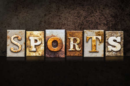 athletic type: The word SPORTS written in rusty metal letterpress type on a dark textured grunge background.