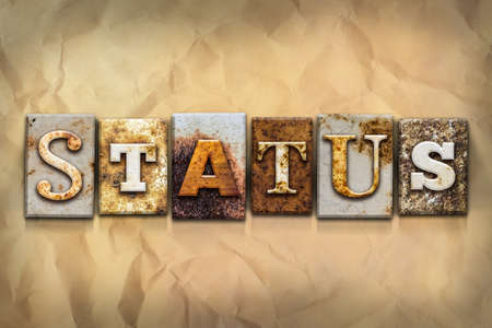 crumbled: The word STATUS written in rusty metal letterpress type on a crumbled aged paper background. Stock Photo