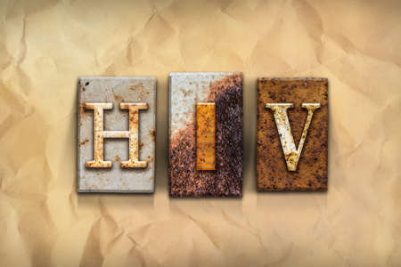 The word HIV  written in rusty metal letterpress type on a crumbled aged paper background.
