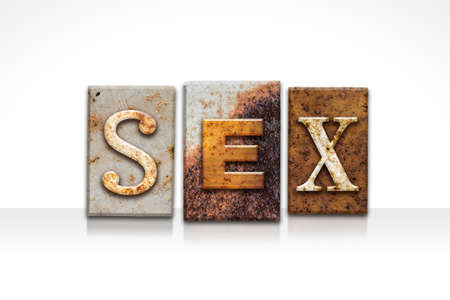 The word SEX written in rusty metal letterpress type isolated on a white background.