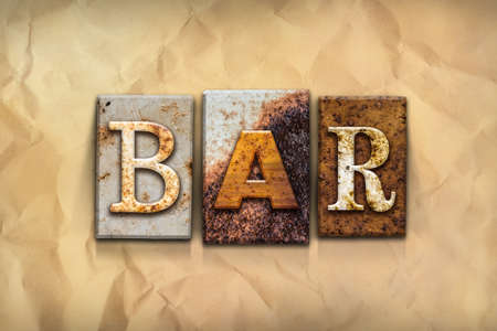 type bar: The word BAR written in rusty metal letterpress type on a crumbled aged paper background. Stock Photo