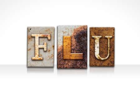 flu shots: The word FLU written in rusty metal letterpress type isolated on a white background.