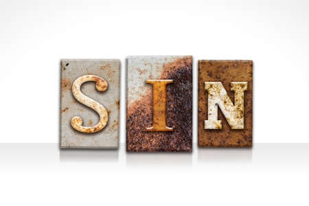 sinful: The word SIN written in rusty metal letterpress type isolated on a white background.