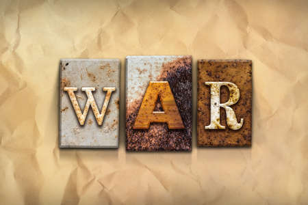 strife: The word WAR written in rusty metal letterpress type on a crumbled aged paper background.