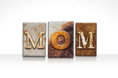 matron: The word MOM written in rusty metal letterpress type isolated on a white background.