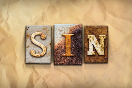 transgression: The word SIN written in rusty metal letterpress type on a crumbled aged paper background. Stock Photo