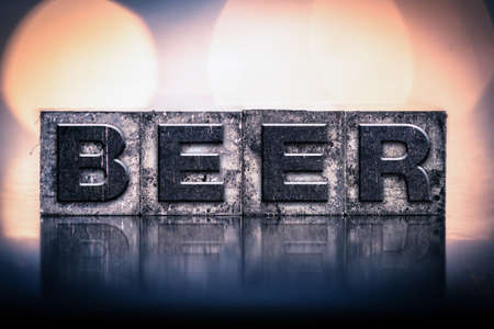 letterpress type: The word BEER written in vintage ink stained letterpress type. Stock Photo
