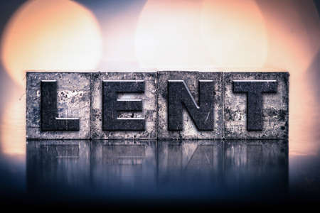 atonement: The word LENT written in vintage ink stained letterpress type.