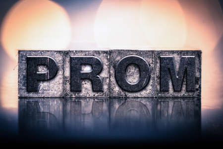 letterpress type: The word PROM written in vintage ink stained letterpress type.