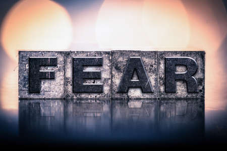 fear: The word FEAR written in vintage ink stained letterpress type.