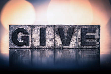 giver: The word GIVE written in vintage ink stained letterpress type. Stock Photo