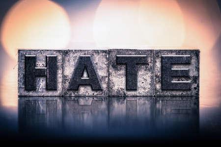 letterpress type: The word HATE written in vintage ink stained letterpress type.