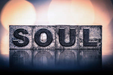 The word SOUL written in vintage ink stained letterpress type.