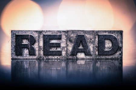 letterpress type: The word READ written in vintage ink stained letterpress type.