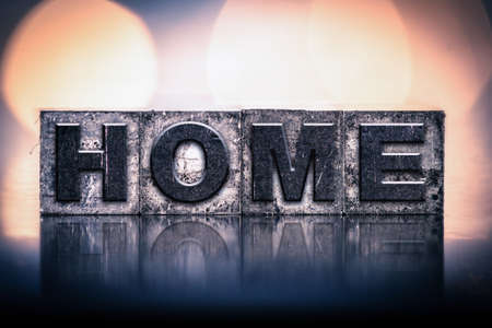 homecoming: The word HOME written in vintage ink stained letterpress type. Stock Photo