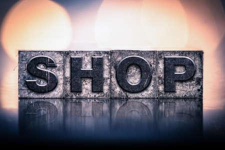 letterpress type: The word SHOP written in vintage ink stained letterpress type. Stock Photo