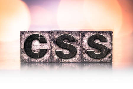 css: The word CSS written in vintage ink stained letterpress type.