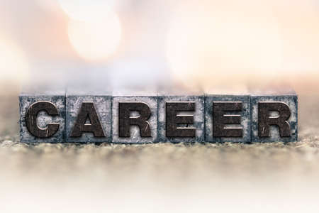 The word CAREER written in vintage ink stained letterpress type.