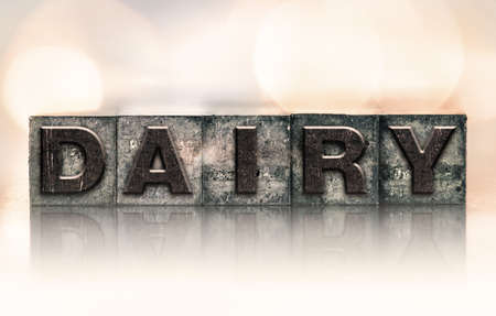 letterpress type: The word DAIRY written in vintage ink stained letterpress type. Stock Photo