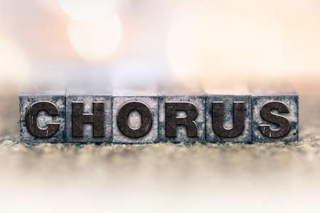 harmonize: The word CHORUS written in vintage ink stained letterpress type.