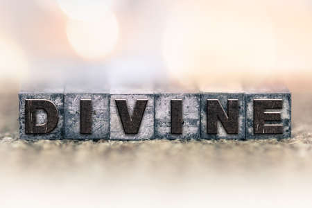 godlike: The word DIVINE written in vintage ink stained letterpress type.