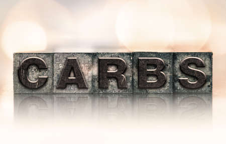 carbs: The word CARBS written in vintage ink stained letterpress type. Stock Photo
