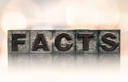 The word FACTS written in vintage ink stained letterpress type. Banco de Imagens