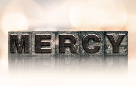 clemency: The word MERCY written in vintage ink stained letterpress type.