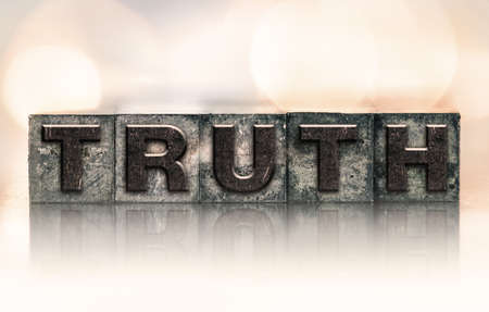 factual: The word TRUTH written in vintage ink stained letterpress type. Stock Photo