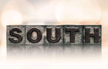 letterpress type: The word SOUTH written in vintage ink stained letterpress type.